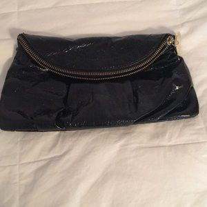 BRAND NEW black clutch with gold trimming